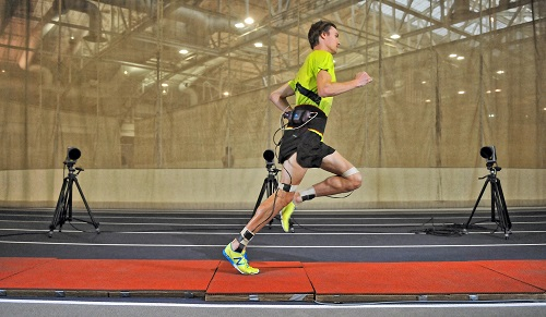 Team New Balance runner Jack Bolas takes a spin around the test track at the company's sports research lab - Credit EOS